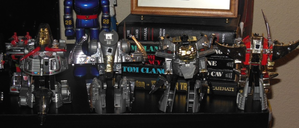 Generation 1 Dinobots by Hasbro Slag, Sludge, Grimlock, Snarl from 1984 Autobots G1 back of robots