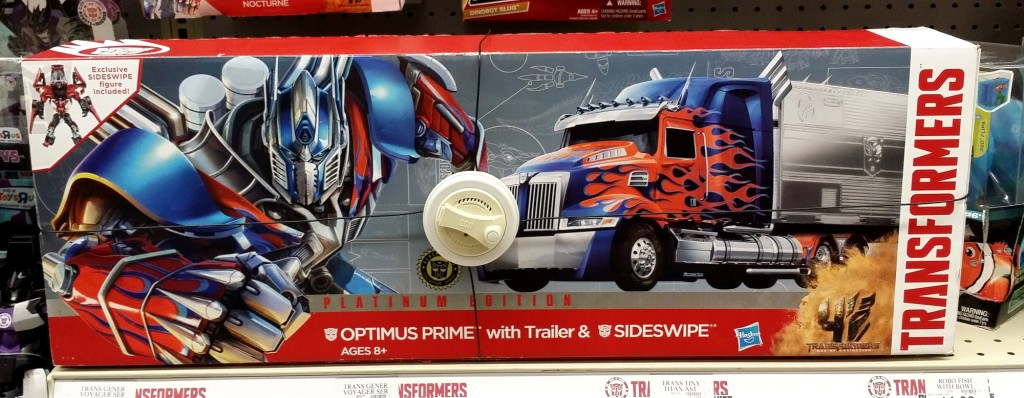Age of Extinction Platinum Optimus Prime With Trailer & Sideswipe 2014 front of box